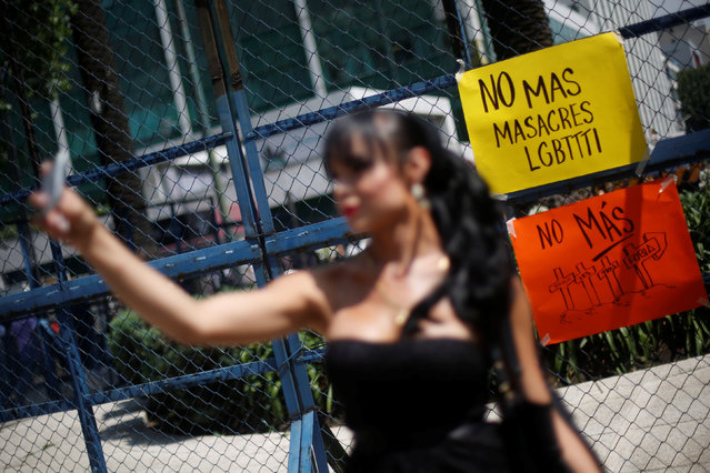"A sign that reads ""No more massacres LGBT"" is seen to remember the victims of the Pulse nightclub mass shooting in Orlando, near the U.S. Embassy in Mexico City, Mexico, June 14, 2016. (Photo by Edgard Garrido/Reuters)"