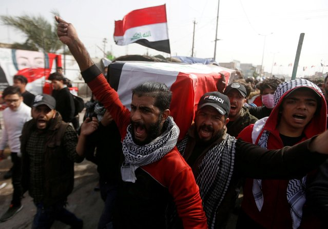 Mourners carry a coffin of an Iraqi activist female protester, who was killed by an unknown gunmen at anti-government protests, during a funeral in Basra, Iraq on January 22, 2020. (Photo by Essam al-Sudani/Reuters)