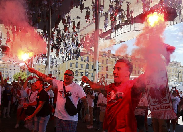 Football Soccer, EURO 2016, Marseille, France on June 21, 2016. Poland fans are reflected in a mirrored ceiling as they wave flares at the old port of Marseille, France.      REUTERS/Wolfgang Rattay