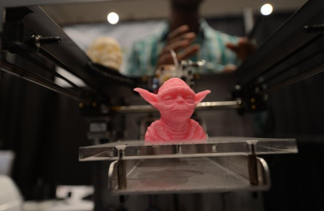 """A sample object, printed with a 3D printer, is on display during the """"Inside 3D Printing"""" conference and exhibition in New York on April 22, 2013. The exhibition features tutorials and seminars offering blueprints on how to invest and utilize 3D printing in coming years, as well as leading manufacturers and developers displaying their latest 3D printers and services. (Photo by Emmanuel Dunand/AFP Photo)"""