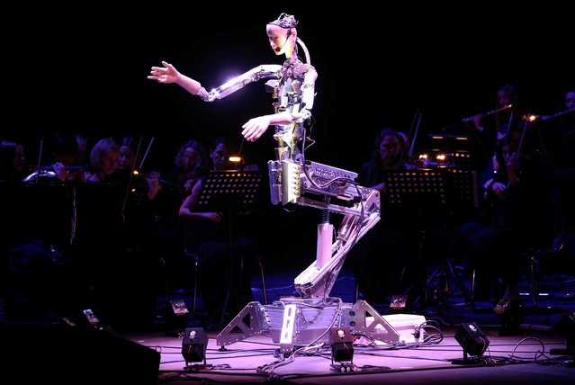 A robot maestro leads an orchestra at the Sharjah Performing Arts Academy in Sharjah, UAE, January 31, 2020. (Photo by Satish Kumar/Reuters)