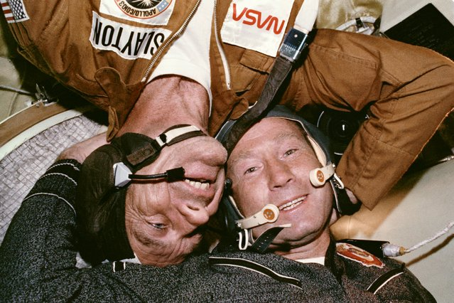 Astronaut Donald K. Slayton and cosmonaut Aleksey A. Leonov are seen together in the Soyuz Orbital Module during the joint U.S.-USSR Apollo-Soyuz Test Project docking mission in Earth orbit. Slayton is the docking module pilot of the American crew. Leonov is the Soviet crew commander. 17-19 July 1975. (Photo by NASA)