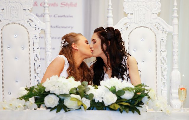 Sharni Edwards, 27, and Robyn Peoples, 26, a Belfast couple who are the first known same-s*x couple to get married in Northern Ireland, kiss after being married, in Carrickfergus, Northern Ireland on February 11, 2020. (Photo by Phil Noble/Reuters)