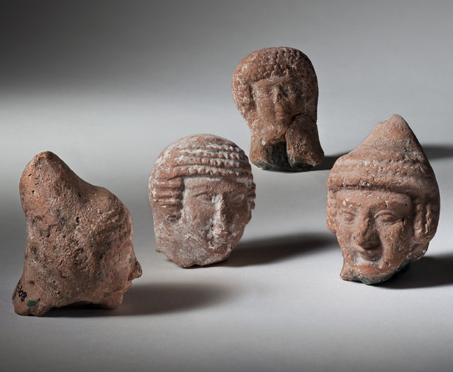 "This handout photo provided by the Israel Antiquities Authority (IAA) shows pottery heads of ""pillar"" figurines, Jerusalem and other Judean sites. Iron Age II , 8th-6th century BCE. The Museum of the Bible, now under construction in Washington, will feature ancient artifacts and treasures from the Holy Land under a new deal with the Israel Antiquities Authority. (Photo by Israel Antiquities Authority/Meidad Suchowolski via AP Photo)"