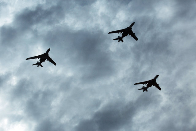 Chinese military planes take part in rehearsals ahead of the Sept. 3 military parade to commemorate the end of World War II in Beijing, Sunday, August 23, 2015. China is ramping up publicity for its upcoming massive military parade but officials still aren't saying what other countries are taking part. (Photo by Ng Han Guan/AP Photo)