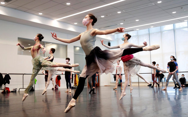Dancers of The Shanghai Ballet take part in a training session at a dance studio amid the coronavirus outbreak on March 2, 2020 in Shanghai, China. The Shanghai Ballet is preparing for a scheduled tour in June this year. (Photo by Tang Yanjun/China News Service via Getty Images)