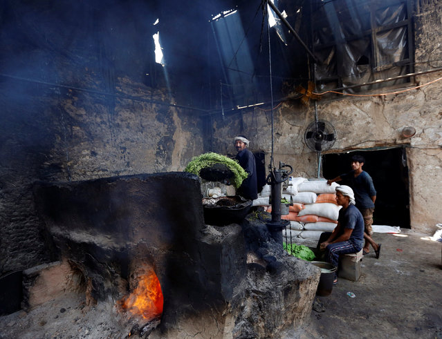 Afghan men make sweets at a small traditional factory during the holy Muslim fasting month of Ramadan in preparation for Eid al-Fitr in Kabul, Afghanistan July 3, 2016. (Photo by Mohammad Ismail/Reuters)