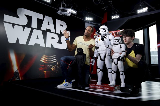 """Model Dante Carver (L) from the U.S. and YouTuber Einshine participate in a live internet unboxing event to reveal 48-inch and 31-inch figure models called First Order's Stormtrooper Battle Buddy and 31-inch figure model called Kylo Ren (in front of Dante) from the film """"Star Wars – The Force Awakens"""", at YouTube Space Tokyo in Tokyo, September 3, 2015.  (Photo by Issei Kato/Reuters)"""