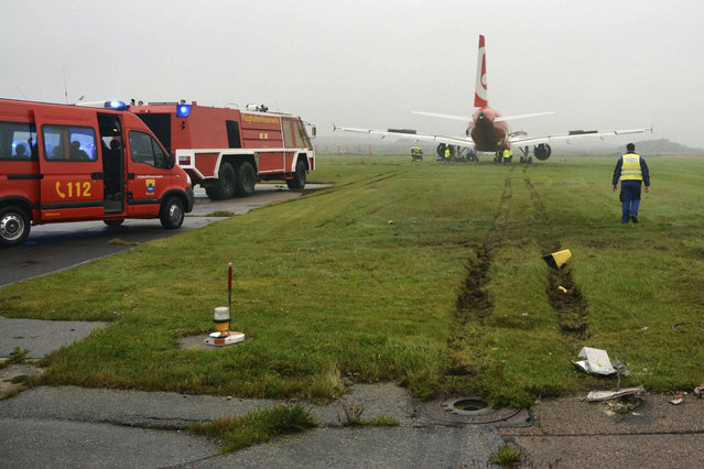 In this picture released by the fire brigade Westerland (Freiwillige Feuerwehr Westerland), an Airbus of Air Berlin stands in a meadow near Westerland on the German North Sea island of Sylt, Saturday, September 30, 2017. German authorities say the plane overshot the end of the runway  but nobody was injured in the incident. The regional emergency response center says the Air Berlin plane from Duesseldorf came to halt on grass about 50 meters beyond the end of the runway Saturday. (Photo by Joerg Elias/Freiwillige Feuerwehr Westerland/DPA via AP Photo)