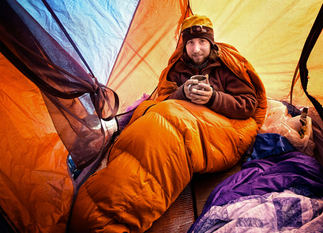 Russian Photographer Oleg Grigoriev in his tent. (Photo by Caters News/Oleg Grigoriev)