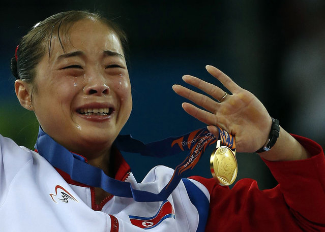North Korea's gold medallist Kim Un Hyang cries during the medal ceremony for the women's beam final of the artistic gymnastics competition at the Namdong Gymnasium Club during the 17th Asian Games in Incheon September 25, 2014. (Photo by Jason Reed/Reuters)