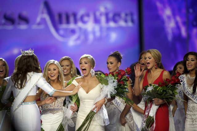 Miss America contestants greet winner Miss Georgia Betty Cantrell (L) after she was crowned Miss America 2016 at Boardwalk Hall in Atlantic City, New Jersey, September 13, 2015. (Photo by Mark Makela/Reuters)