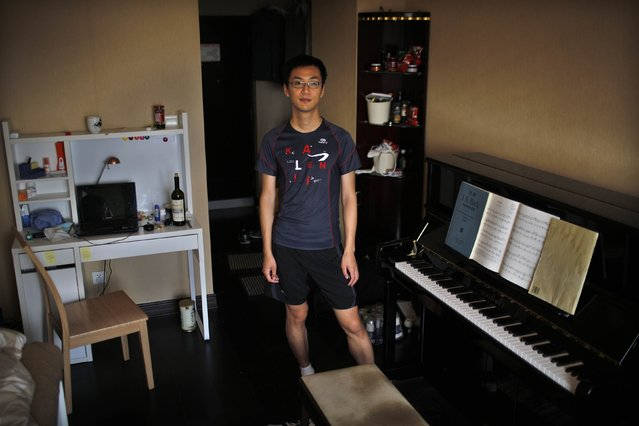 "Dai Chen, who was born in 1988, poses for a photograph in Shanghai July 23, 2014. Chen said: ""I don't want to have siblings because if I had a brother or a sister I would have to share. It would be difficult to get a good education"". (Photo by Carlos Barria/Reuters)"