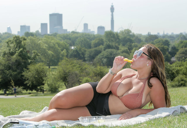 Elley Dann indulges in some sunbathing in Primrose Hill, London on June 24, 2020, after the UK officially recorded its warmest day of the year so far when the temperature reached 32.6C (90.7F) at London's Heathrow Airport at 2.46pm. (Photo by Evening Standard/The Sun)