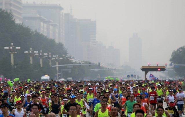 Participants run in the Beijing International Marathon in Beijing, China, September 20, 2015. (Photo by Kim Kyung-Hoon/Reuters)