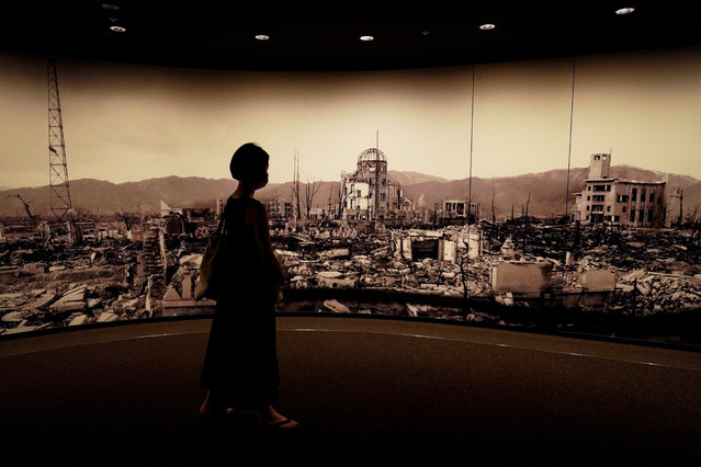 A visitor looks at photographs of the Hiroshima bombing aftermath, at the Hiroshima Peace Memorial Museum in Hiroshima, Japan, 05 August 2020. On 06 August 2020 Japan will mark the 75th anniversary of the bombing of Hiroshima. In 1945 the United States dropped two nuclear bombs over the cities of Hiroshima and Nagasaki on 06 and 09 August respectively, killing more than 200,000 people. This year's annual commemoration events were either canceled or scaled down amid the ongoing coronavirus pandemic. (Photo by Dai Kurokawa/EPA/EFE)