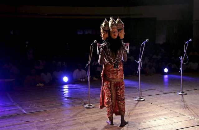 An Indian actor dressed as Hindu god Brahma performs during a play based on Hindu mythology at a theater in Bangalore, India, Thursday, October 30, 2014. Different stories in Hindu mythology have been passed on from generation to generation either by word of mouth or through stored scriptures. (Photo by Aijaz Rahi/AP Photo)
