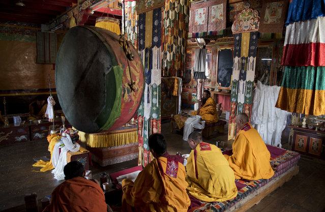 In this August 18, 2016, photo, Buddhist monks perform their daily rituals in the monastery of Komic in Spiti Valley, India. (Photo by Thomas Cytrynowicz/AP Photo)