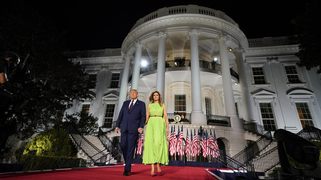 President Donald Trump and first lady Melania Trump arrive for his acceptance speech to the Republican National Committee Convention on the South Lawn of the White House, Thursday, August 27, 2020, in Washington. (Photo by Evan Vucci/AP Photo)