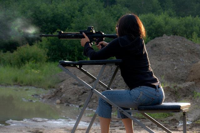 """""""AR-15 Girl"""". (Photo by Eric Deutchman)"""
