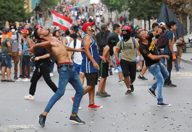 Demonstrators throw stones during anti-government protests in Beirut, Lebanon on September 1, 2020. (Photo by Mohamed Azakir/Reuters)