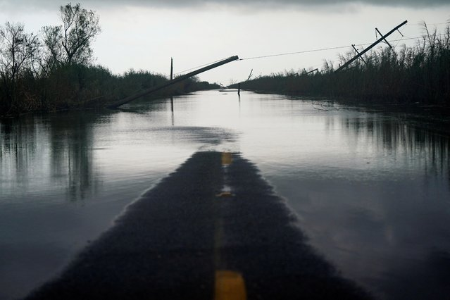 Downed power lines and flooding is seen after Hurricane Laura passed through the area in Creole, Louisiana, U.S. August 28, 2020. (Photo by Elijah Nouvelage/Reuters)