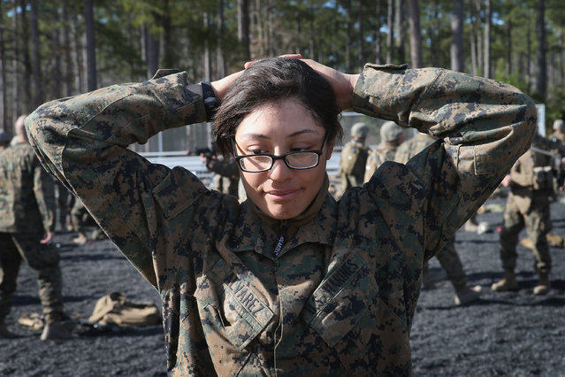 Pfc. Cristiana Alvarez from Milwaukee, Wisconsin works on searching procedures during Marine Combat Training (MCT) on February 20, 2013 at Camp Lejeune, North Carolina.  Since 1988 all non-infantry enlisted male Marines have been required to complete 29 days of basic combat skills training at MCT after graduating from boot camp. MCT has been required for all enlisted female Marines since 1997. About six percent of enlisted Marines are female.  (Photo by Scott Olson)