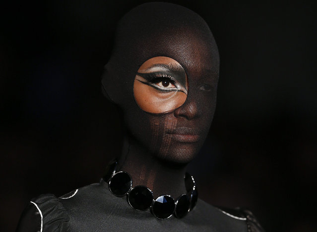 A model wears a creation from the Alexandre Herchcovitch winter collection during the Sao Paulo Fashion Week in Sao Paulo, Brazil, Sunday, October 18, 2015. (Photo by Andre Penner/AP Photo)