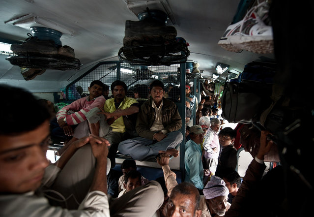 Indian women travel in a crowded coach on a train at a railway station in New Delhi when Railway Minister Pawan Kumar Bansal unveiled the railway budget in parliament. (Photo by Manan Vatsyayana)