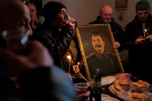 People drink wine during a gathering to mark the anniversary of Soviet leader Joseph Stalin's death in his hometown of Gori, Georgia, March 5, 2018. (Photo by David Mdzinarishvili/Reuters)