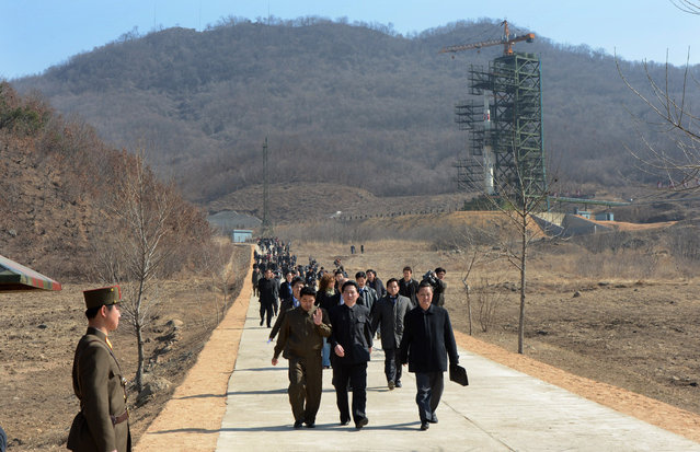 North Korean officials and foreign journalists leave the launch pad after a visit to see the rocket Unha-3 at Tangachai -ri space center on April 8, 2012. (Photo by Pedro Ugarte/AFP Photo)