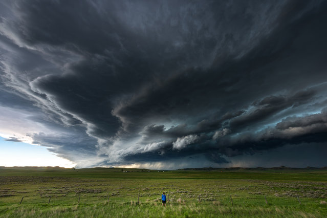 A photographer has weathered some of America's most violent storms to capture these stunning snaps. Storm chaser Mike Mezeul II, 30, has traveled all over the US to shoot the likes of mammoth thunderstorms and surreal cloud patterns. His incredible collection of storm images are the result of more than 15 years of photography and thousands of miles of travel. (Photo by Mike Mezeul II/Caters News)
