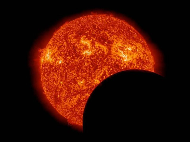 NASA's Solar Dynamics Observatory caught this view of the moon crossing in front of the sun on March 11, 2013. The transit took place during the sun-observing probe's semiannual eclipse season, a period of three weeks when SDO's view of the sun is occasionally blocked by Earth or the moon. (Photo by NASA via EPA)