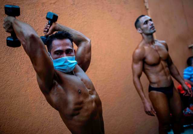 Bodybuilders prepare to participate in the National Bodybuilding Championship in Managua on October 31, 2020, amid the new coronavirus pandemic. (Photo by Inti Ocon/AFP Photo)