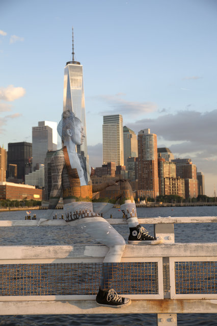 A New York artist has used body paint to perfectly camouflage her subjects into a variety of famous landmarks. Trina Merry, who specialises in bodypainting, line her subjects up and photographed them as they appeared to blend right into the scenery around them. The backdrops to her eye-catching art include the White House, Freedom Tower, Grand Central Station, the Golden Gate Bridge, and even Irelands Giants Causeway. By painting her subjects into a modern background, Trina is putting a modern twist on the oldest art form known to man. Here: A woman blends into the New York skyline and Freedom Tower. (Photo by Trina Merry/Caters News)