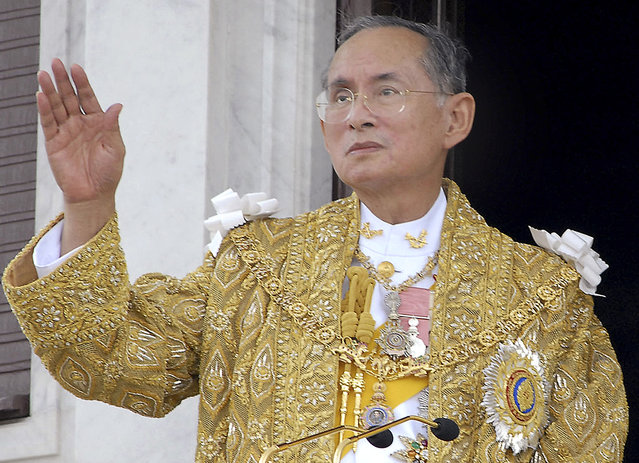 In this June 9, 2006, file photo released by the Thai Government Public Relations Department, Thailand King Bhumibol Adulyadej acknowledges the crowd in Bangkok during the celebrations of the 60th anniversary of his accession to the throne. (Photo by Thai Government Public Relations Department via AP Photo)