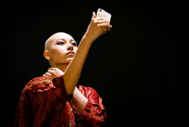 A model takes a selfie in the backstage, during Kazakhstan Fashion Week in Almaty, Kazakhstan April 10, 2018. (Photo by Shamil Zhumatov/Reuters)