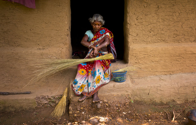 In this September 11, 2014 photo, Baleman Sundi prepares brooms to sell at her home in Roro, India. (Photo by Saurabh Das/AP Photo)