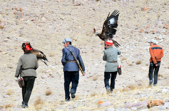 Eagle hunters headed to the mountain to go eagle hunting. (Photo by Brad Ruoho/The Star Tribune)