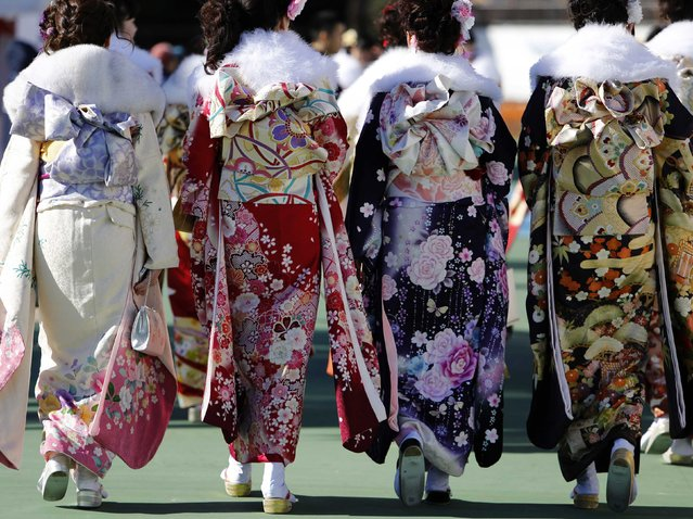 Japanese women in kimonos attend a Coming of Age Day celebration ceremony at an amusement park in Tokyo January 12, 2015. (Photo by Yuya Shino/Reuters)