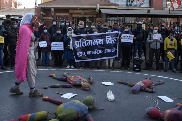 Civil society activists participate in a demonstration against the dissolution of the country's parliament, in Kathmandu on December 26, 2020. (Photo by Prakash Mathema/AFP Photo)