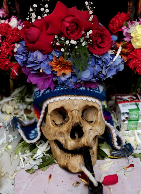 A skull is seen at a cemetery during the Day of Skulls in La Paz, Bolivia, November 8, 2016. (Photo by David Mercado/Reuters)