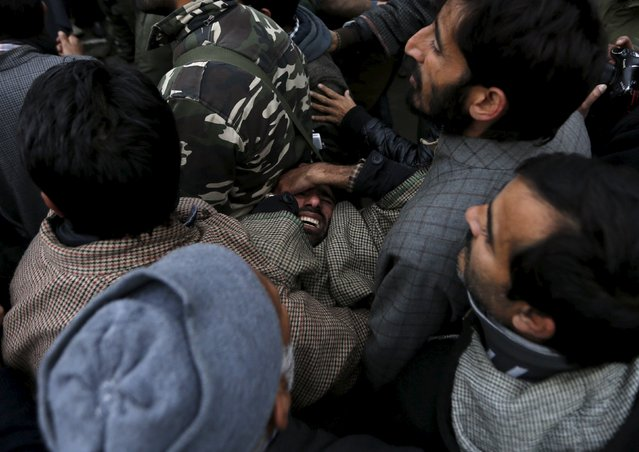 Supporters of Kashmiri lawmaker Sheikh Abdul Rashid, commonly known as Engineer Rashid, carry an injured comrade during a demonstration to mark International Human Rights Day in Srinagar December 10, 2015. Dozens of the supporters of Rashid on Thursday held a protest against what the supporters say are human rights violations in Kashmir. (Photo by Danish Ismail/Reuters)
