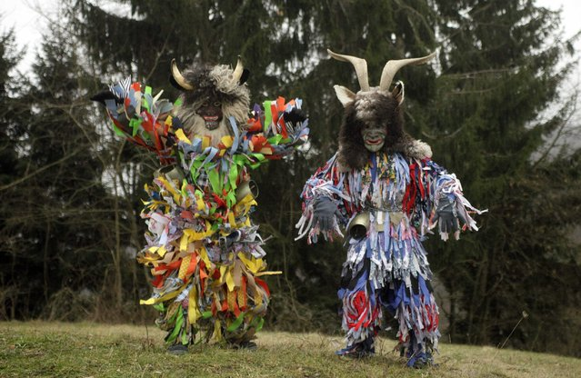 """Members of the Liski Pustje Ethnological Society dressed up as traditional native characters named """"Pustje"""" pose ahead of the Carnival in Kanal ob Soci January 14, 2015. (Photo by Srdjan Zivulovic/Reuters)"""