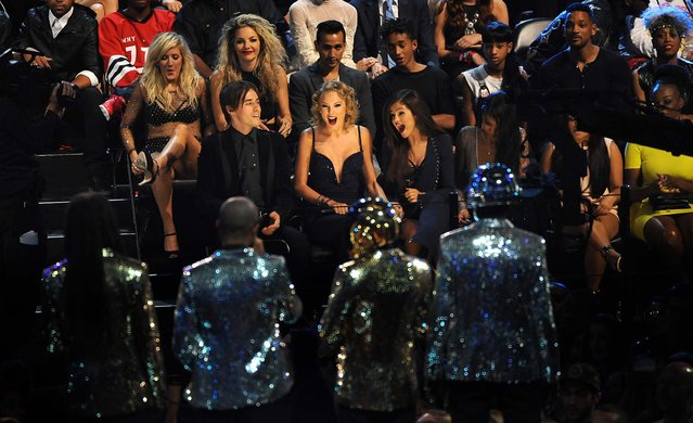 """Taylor Swift, seated center, reacts after it was announced she won the award for best female video for """"I Knew You Were Trouble"""". (Photo by Scott Gries/Invision)"""