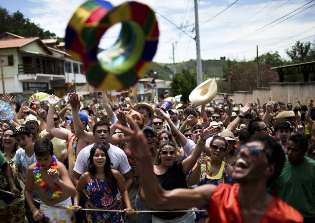 "Revellers take part in an annual carnival block party known as ""Juca Teles"" in Sao Luiz do Paraitinga February 14, 2015. (Photo by Roosevelt Cassio/Reuters)"