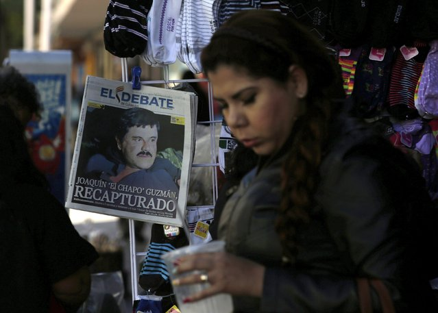 "A woman walks past a newspaper showing a photograph of recaptured drug lord Joaquin ""Chapo"" Guzman on its front page in Culiacan, Mexico, January 9, 2016. (Photo by Daniel Becerril/Reuters)"