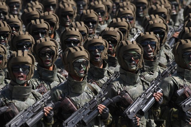 Korean People' s Army (KPA) soldiers march during a mass rally on Kim Il Sung square in Pyongyang on September 9, 2018. North Korea held a military parade to mark its 70 th birthday, but refrained from showing off the intercontinental ballistic missiles that have seen it hit with multiple international sanctions. (Photo by Ed Jones/AFP Photo)