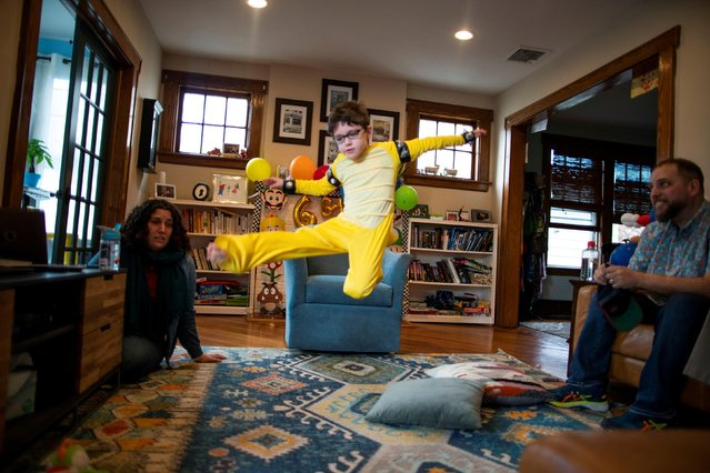 Reuben Goodman jumps during his 6th birthday Zoom party, after all family members have been vaccinated against the coronavirus disease (COVID-19), in South Orange, New Jersey U.S., April 17, 2021. (Photo by Eduardo Munoz/Reuters)