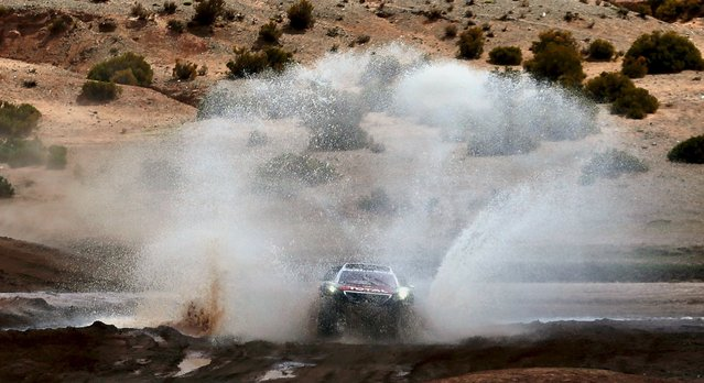 Carlos Sainz of Spain drives his Peugeot during the seventh stage in the Dakar Rally 2016 in Uyuni, Bolivia, January 9, 2016. (Photo by Marcos Brindicci/Reuters)